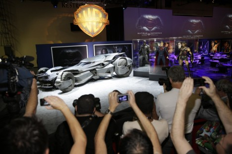 "Members of the media and fans gather as Warner Bros. Consumer Products exclusively unveils the Batmobile and select costumes from the highly anticipated film, ""Batman v Superman: Dawn of Justice"" at Licensing Expo 2015 on Tuesday, June 9, 2015 in Las Vegas. (Photo by Isaac Brekken/Invision for Warner Bros./AP Images)"