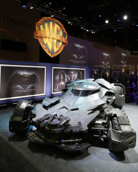 "Warner Bros. Consumer Products exclusively unveils the Batmobile and select costumes from the highly anticipated film, ""Batman v Superman: Dawn of Justice"" at Licensing Expo 2015 on Tuesday, June 9, 2015 in Las Vegas. (Photo by Isaac Brekken/Invision for Warner Bros./AP Images)"