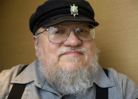 "In this March 12, 2012 photo, George R.R. Martin, author of the popular book series ""A Song of Ice and Fire,"" which inspired the hit HBO series ""Game of Thrones"" poses in Toronto. The second season of ""Game of Thrones"" premieres on April 1.  (AP Photo/The Canadian Press, Nathan Denette)"